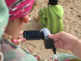 Filming at the beach during a participatory video workshop