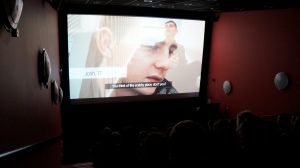 Screenshot from the film at the first official screening. Josh is talking about what he thought a hostel would be like before he had to live in one himself