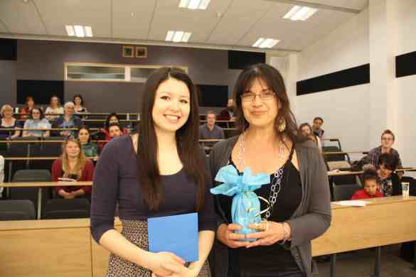 Anastasia To receiving the Runner-Up audience prize from Dr Daniela Peluso.